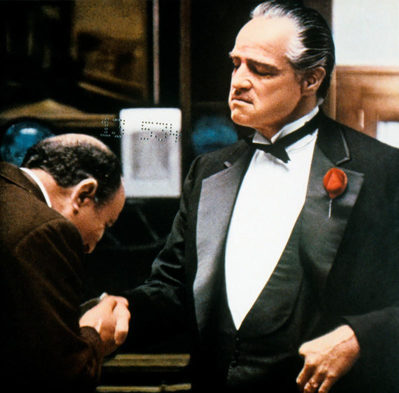Italian actor Salvatore Corsitto kissing the hand of the American actor Marlon Brando in The Godfather. USA, 1972 (Photo by Mondadori Portfolio by Getty Images)