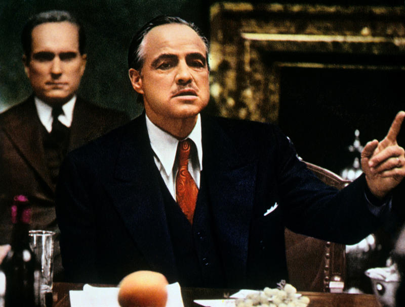 American actor Marlon Brando sitting at the table and talking in The Godfather. USA, 1972 (Photo by Mondadori Portfolio by Getty Images)