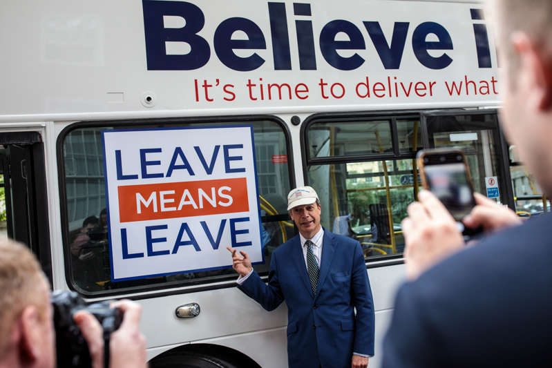 LONDON, ENGLAND - SEPTEMBER 20: MEP and former leader of the UK Independence Party Nigel Farage poses for photographers in front of the pro-Brexit 'Leave Means Leave' campaign bus in Westminster on September 20, 2018 in London, England. The political campaign group launch a series of billboards today calling on the government to scrap the so-called Chequers Brexit plan. (Photo by Jack Taylor/Getty Images)