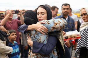 WELLINGTON, NEW ZEALAND - MARCH 17: Prime Minister Jacinda Ardern hugs a mosque-goer at the Kilbirnie Mosque on March 17, 2019 in Wellington, New Zealand. 50 people are confirmed dead and 36 are injured still in hospital following shooting attacks on two mosques in Christchurch on Friday, 15 March. The attack is the worst mass shooting in New Zealand's history. (Photo by /Getty Images)