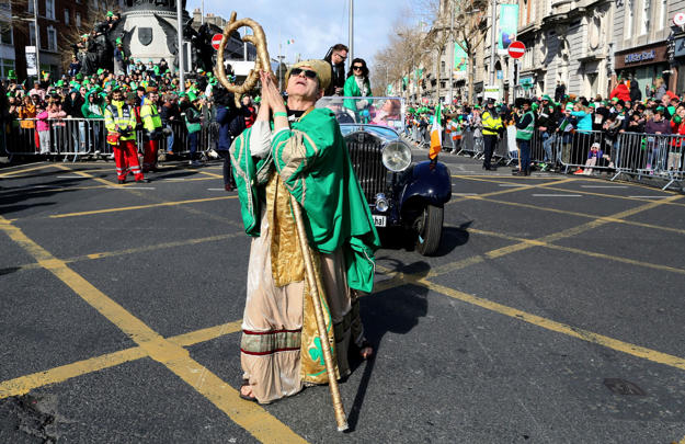 St Patrick leads the  start of the annual St Patricks Day parade through the city centre of Dublin on March 17, 2019. (Photo by Paul FAITH / AFP)        (Photo credit should read PAUL FAITH/AFP/Getty Images)