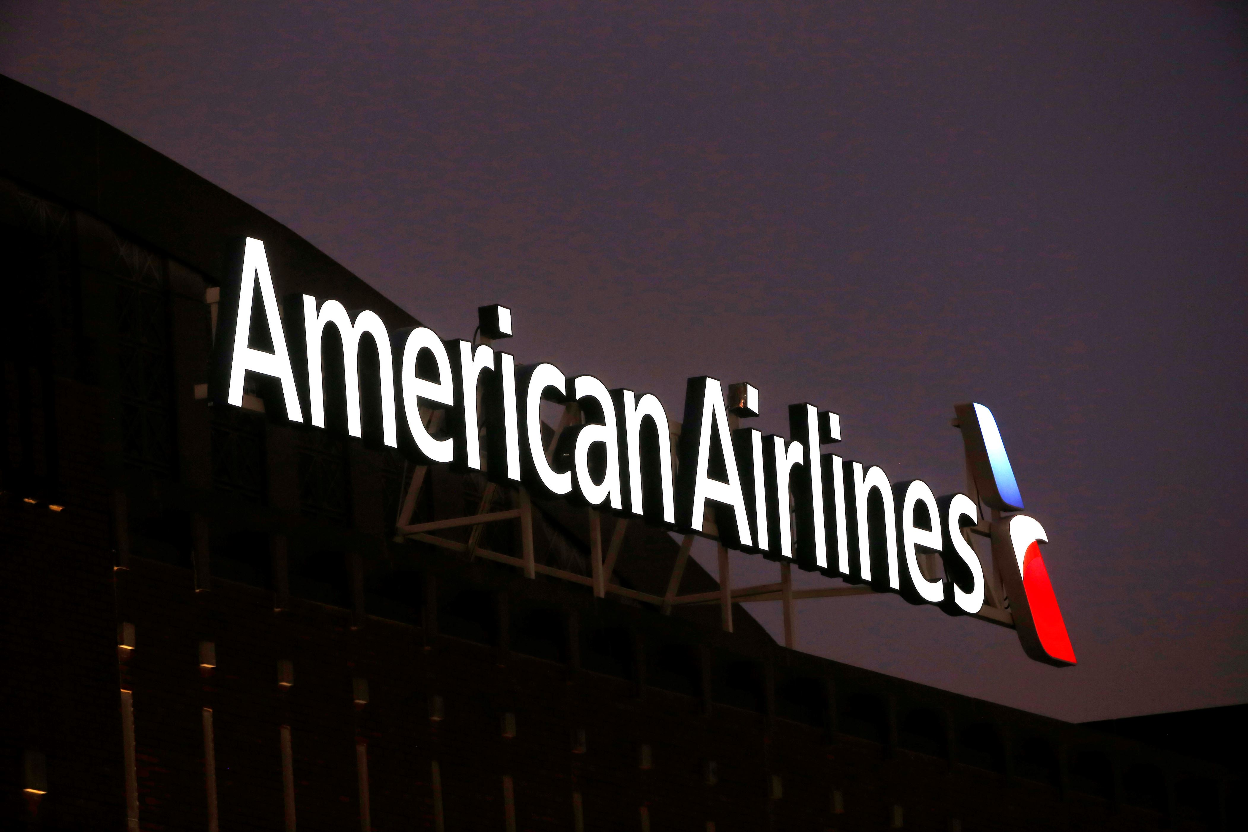 This Dec. 19, 2017, photo shows the American Airlines logo on top of the American Airlines Center in Dallas. American Airlines reported Thursday, Jan. 25, 2018, that fourth-quarter profit slipped 11 percent as higher costs for fuel and labor offset rising revenue. (AP Photo/ Michael Ainsworth)