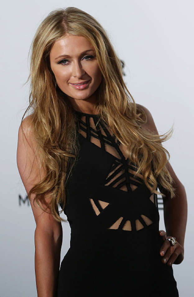 f218bdcfbd39 FILE- Paris Hilton attends AmFar dinner at Shaw Studio, Clearwater Bay.