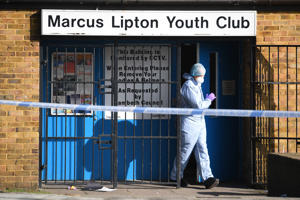 LONDON , ENGLAND - FEBRUARY 22: Forensic police officers attend the Marcus Lipton Youth Club in Minet Road after a 23-year-old man was fatally stabbed yesterday on February 22, 2019 in London, England. (Photo by Leon Neal/Getty Images)