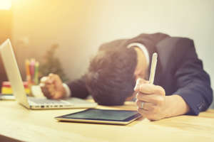 Finance & Business.Office,technology,internet, business,Exhausted businessman falling asleep at his office desk,entrepreneur, trader, tycoon, operator,Frustrated stressed in office,vintage color,