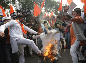 Hindu Sena Supporters burning the effigy of Jaish-e-Mohammad and Prime Minister of Pakistan, Imran Khan to protest against the terror attack in Pulwama, at Jantar Mantar, in New Delhi.