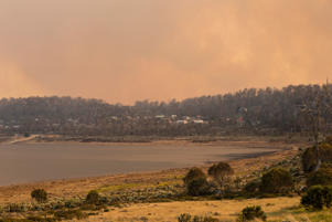 MIENA, AUSTRALIA - JANUARY 21: Tasmania's Great Lake is smothered by smoke as vegetation fire comes dangerously close on January 21, 2019 in Miena, Australia. The Tasmania Fire Service (TFS) has issued an emergency warning for Miena with the town in Tasmania's Central Plateau at very high risk. Residents have been told to enact their bushfire emergency plans. (Photo by Heath Holden/Getty Images)