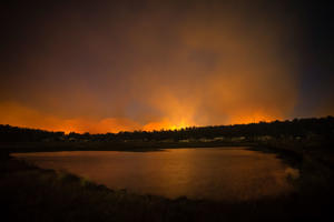 MIENA, AUSTRALIA - JANUARY 22: Fires burning dangerously close can be seen from the Central Highlands Lodge from on January 22, 2019 in Miena, Australia. Around 40 residents from the small town of Miena in Tasmania's Central Plateau have been evacuated, as bushfires continue to burn in the area. Bushfire warnings have been downgraded to watch and act, but the Tasmanian Fire Service is still warning that ash and embers are still a risk. (Photo by Heath Holden/Getty Images)
