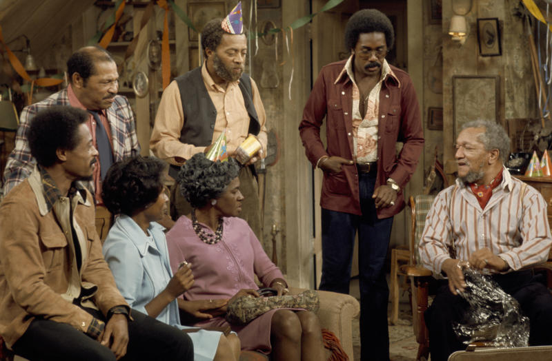 SANFORD AND SON -- 'The Surprise Party' Episode 1 -- Aired 9/13/74 -- Pictured: (back row l-r) Don Bexley as Bubba Bexley, Whitman Mayo as Grady Wilson, Demond Wilson as Lamont Sanford, Redd Foxx as Fred G. Sanford (front row l-r) Nathaniel Taylor as Rollo Larson, Lynn Hamilton as Donna Harris, LaWanda Page as Aunt Esther (Photo by NBC/NBCU Photo Bank via Getty Images)