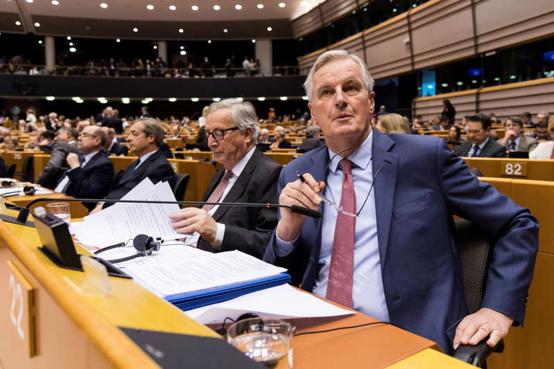 """EU Commission President Jean Claude Juncker, center, and European Union chief Brexit negotiator Michel Barnier, right, prepare to address Members of European Parliament on Brexit during a plenary session at the European Parliament in Brussels on Wednesday Jan. 30, 2019. Leaders across the European Union offered a united chorus of """"No"""" on Wednesday to Britain's belated bid to negotiate changes to the Brexit divorce deal so Prime Minister Theresa May can win the backing of her Parliament. (AP Photo/Geert Vanden Wijngaert)"""