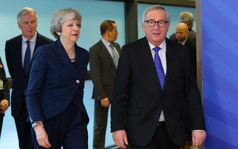BRUSSELS, BELGIUM - FEBRUARY 07 : British Prime Minister Theresa May (Front L) walks with President of the European Commission Jean-Claude Juncker (R) during their meeting at European Commission in Brussels, Belgium on February 07, 2019. EU Chief Brexit Negotiator Michel Barnier (Rear L) also attended the meeting.  (Photo by Dursun Aydemir/Anadolu Agency/Getty Images)