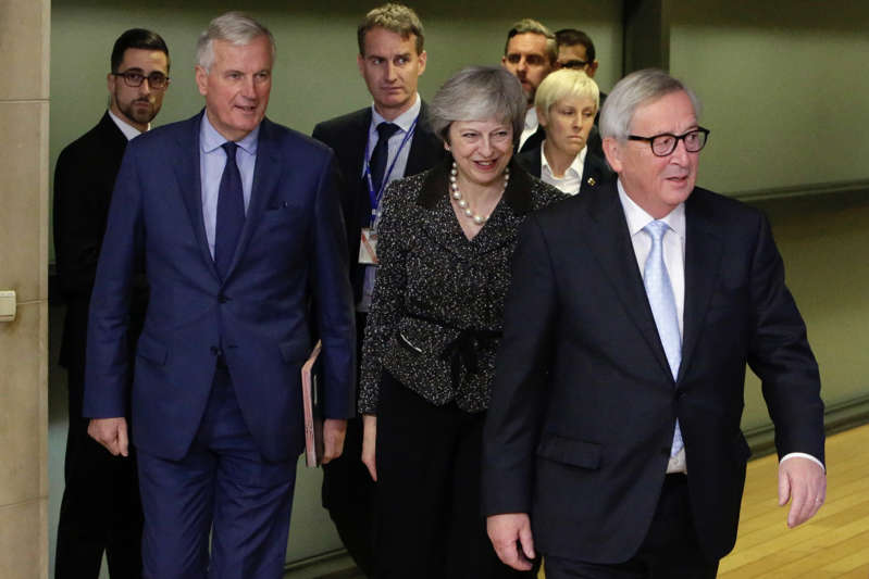 British Prime minister Theresa May (C) is welcomed by European Commission president Jean-Claude Juncker (R) and EU negotiator Michel Barnier prior to their meeting as part of the Brexit negociations, on December 11, 2018 in Brussels. (Photo by Aris Oikonomou / AFP)        (Photo credit should read ARIS OIKONOMOU/AFP/Getty Images)