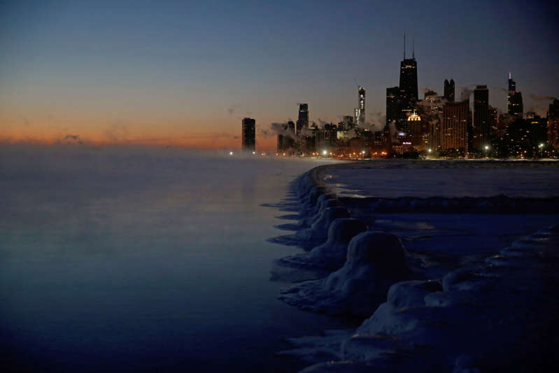 Ice forms along the shore of Lake Michigan before sunrise, Thursday, Jan. 31, 2019, in Chicago. The painfully cold weather system that put much of the Midwest into a historic deep freeze was expected to ease Thursday, though temperatures still tumbled to record lows in some places. (AP Photo/Kiichiro Sato)