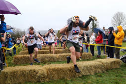 Competitors take part in the annual UK Wife Carrying Race at The Nower in Dorking, Surrey. (Photo by Gareth Fuller/PA Images via Getty Images)