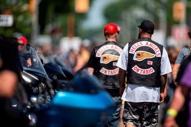 2066935782a Members of the Hells Angels walk among thousands of bikers and motorcycle  enthusiasts on the streets