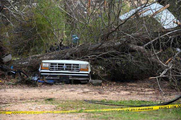 Tornado damage overwhelms the landscape near Lee County Road 38 in Beauregard, Alabama.