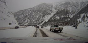 Avalanche engulfs car on Colorado highway