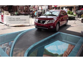 a car parked in a parking lot: 2013 Nissan Pathfinder