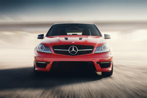 Saratov, Russia - August 24, 2014: Red Sport Car Mercedes-Benz C63 AMG Drive Speed On Asphalt Road At Sunset; Shutterstock ID 383806060; Purchase Order: -