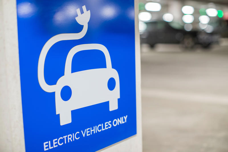 Sign For Electric Car Charging Point In Car Park