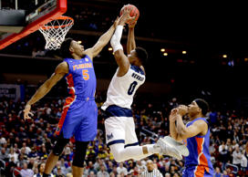 CAPTION: Nevada's Tre'Shawn Thurman (0) goes to the basket against Florida's KeVaughn Allen (5) and Isaiah Stokes, right, during the first half of a first round men's college basketball game in the NCAA Tournament, in Des Moines, Iowa, Thursday, March 21, 2019.