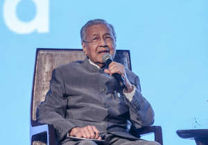 FILE - Malaysia Prime minister Tun Dr Mahathir Mohamad speaks during the Invest Malaysia 2019 conference in Kuala Lumpur March 19, 2019.