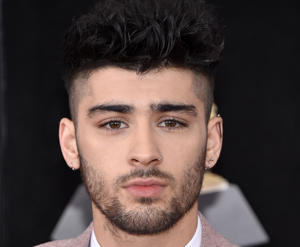 Zayn Malik has apologised for being a 's*** person' just weeks after his One Direction bandmate Louis Tomlinson claimed their friendship ended following his mum's death.