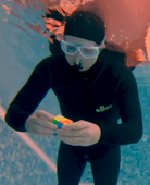 Man attempts world record for solved Rubik's cubes underwater