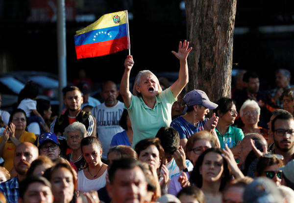 Slide 1 of 65: Supporters attend a gathering with Venezuelan opposition leader Juan Guaido, who many nations have recognised as the country's rightful interim ruler, in Caracas, Venezuela April 5, 2019.