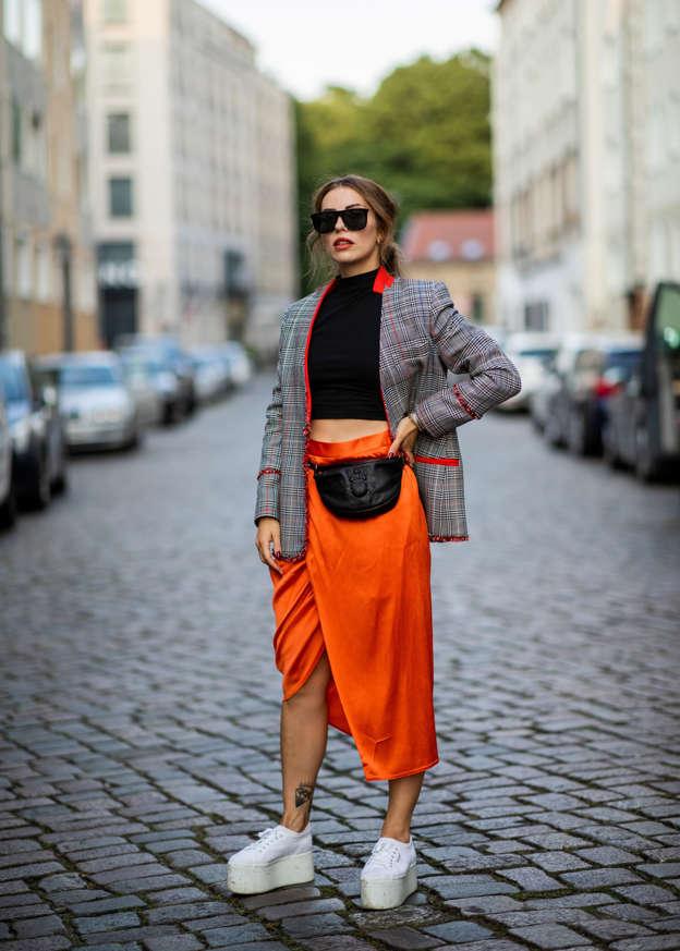 22537f5ffe BERLIN, GERMANY - JULY 31: Masha Sedgwick wearing black cropped top Asos,  orange