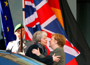German Chancellor Angela Merkel kisses British Prime Minister Theresa May as she leaves after they met to discuss Brexit, at the chancellery in Berlin, Germany, April 9, 2019. REUTERS/Hannibal Hanschke