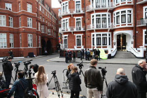 Members of the media gather outside the Ecuadorian Embassy following the arrest of Wikileaks founder, Julian Assange on April 11, 2019 in London, England.