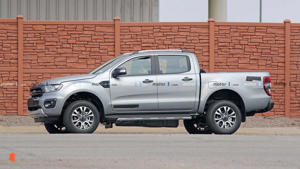 a car parked in front of a brick building: Ford Ranger Diesel Spy Shots