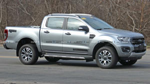 a car parked on the side of a road: Ford Ranger Diesel Spy Shots