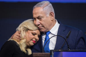 10 April 2019, Israel, Tel Aviv: Benjamin Netanyahu, Prime Minister of Israel, embraces his wife Sara at a post-election event. Several hours after the closure of the polling stations in Israel, only partial results were available on the night of Wednesday. However, these did not allow any reliable conclusions to be drawn about the final result. Photo: Oliver Weiken/dpa (Photo by Oliver Weiken/picture alliance via Getty Images)