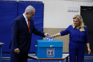 Israel's Prime Minister Benjamin Netanyahu casts his vote with his wife Sara during Israel's parliamentary election in Jerusalem April 9, 2019. Ariel Schalit/Pool via REUTERS *** Local Caption ***