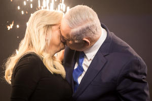 10 April 2019, Israel, Tel Aviv: Benjamin Netanyahu, Prime Minister of Israel, kisses his wife Sara at a post-election event. Several hours after the closure of the polling stations in Israel, only partial results were available on the night of Wednesday. However, these did not allow any reliable conclusions to be drawn about the final result. Photo: Oliver Weiken/dpa (Photo by Oliver Weiken/picture alliance via Getty Images)