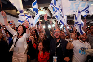 Supporters of the Blue and White (Kahol Lavan) political alliance react after watching a tv poll at the alliance headquarters in Tel Aviv on April 9, 2019. - Prime Minister Benjamin Netanyahu appeared better placed to form a coalition after Israel's general elections on Tuesday despite his party being neck and neck with his main challenger, exit polls showed. (Photo by GALI TIBBON / AFP)        (Photo credit should read GALI TIBBON/AFP/Getty Images)