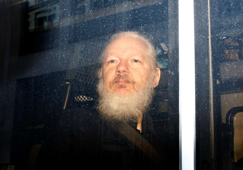WikiLeaks founder Julian Assange is seen in a police van, after he was arrested by British police, in London, Britain.
