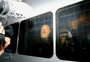 WikiLeaks founder Julian Assange is seen in a police van, after he was arrested by British police, in London, Britain April 11, 2019.