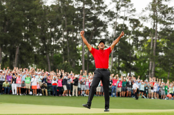 Slide 1 of 116: AUGUSTA, GEORGIA - APRIL 14: (Sequence frame 6 of 12) Tiger Woods of the United States celebrates after making his putt on the 18th green to win the Masters at Augusta National Golf Club on April 14, 2019 in Augusta, Georgia. (Photo by )