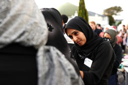 AUCKLAND, NEW ZEALAND - MARCH 22: A muslim woman gives away a free hijab to guests attending the Ponsonby Masjid Mosque during an open service to all religions on March 22, 2019 in Auckland, New Zealand. 50 people were killed, and dozens were injured in Christchurch on Friday, March 15 when a gunman opened fire at the Al Noor and Linwood mosques. The attack is the worst mass shooting in New Zealand's history. (Photo by Hannah Peters/Getty Images)