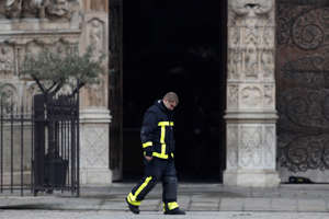 A firefighter works at Notre-Dame Cathedral after a massive fire devastated large parts of the gothic gem in Paris, France, April 16, 2019.  REUTERS/Benoit Tessier