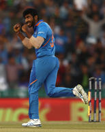 MOHALI, INDIA - MARCH 10: Jasprit Bumrah of India celebrates taking the wicket of Shaun Marsh of Australia during game four of the One Day International series between India and Australia at Punjab Cricket Association Stadium on March 10, 2019 in Mohali, India. (Photo by Robert Cianflone/Getty Images)