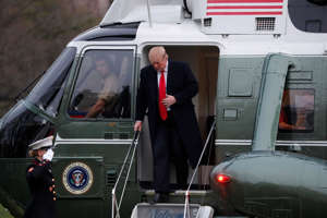 U.S. President Donald Trump steps out of the Marine One helicopter as he returns to the White House after U.S. Attorney General William Barr reported to congressional leaders on the submission of the report of Special Counsel Robert Mueller in Washington, U.S., March 24, 2019. REUTERS/Carlos Barria