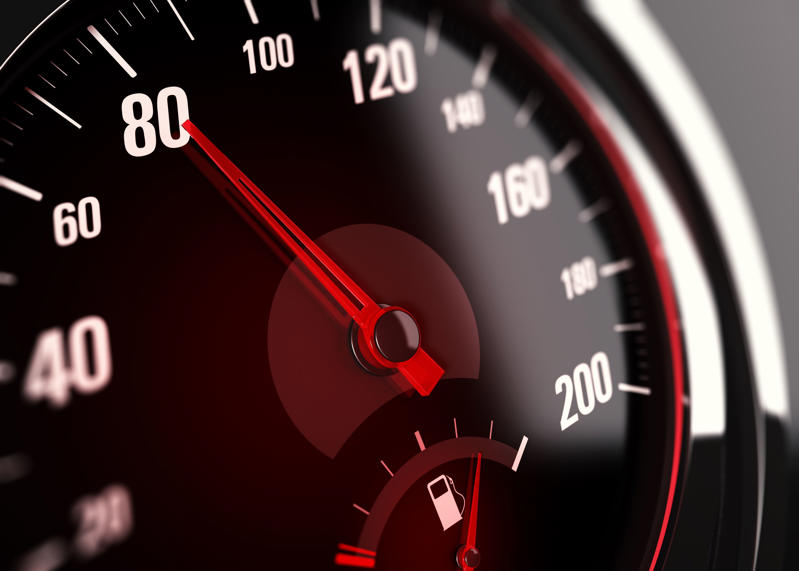 Speedometer with needle pointing the number 80.