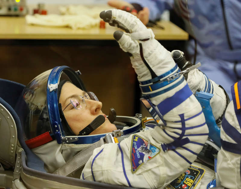 The International Space Station (ISS) crew member Christina Koch of the U.S. looks on during space suit check shortly before launch at the Baikonur Cosmodrome, Kazakhstan March 14, 2019.  REUTERS/Shamil Zhumatov