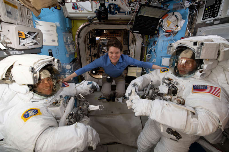 NASA astronaut Anne McClain assists fellow NASA astronauts Christina Koch (L) and Nick Hague as they verify their U.S. spacesuits are sized correctly and fit properly ahead of a set of upcoming spacewalks at the International Space Station on March 18, 2019. Picture taken on March 18, 2019. Courtesy NASA/Handout via REUTERS   ATTENTION EDITORS - THIS IMAGE HAS BEEN SUPPLIED BY A THIRD PARTY.