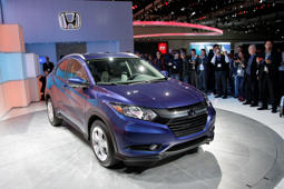 FILE - In this Nov. 19, 2014, file photo, the 2016 Honda HR-V crossover is unveiled at the Los Angeles Auto Show, in Los Angeles. The HR-V is a value-priced, fuel-efficient and eminently practical sport utility vehicle that's easy to drive and smartly packaged with a rearview camera and USB port among the standard features. (AP Photo/Jae C. Hong, File)
