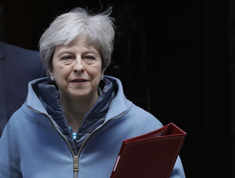 Britain's Prime Minister Theresa May leaves 10 Downing Street in London, Monday, March 25, 2019. Embattled Prime Minister Theresa May was scrambling Sunday to win over adversaries to her Brexit withdrawal plan as key Cabinet ministers denied media reports that they were plotting to oust her. (AP Photo/Kirsty Wigglesworth)